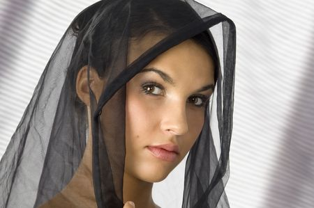 vestal: nice portrait of a young woman with a black veil on her head  Stock Photo