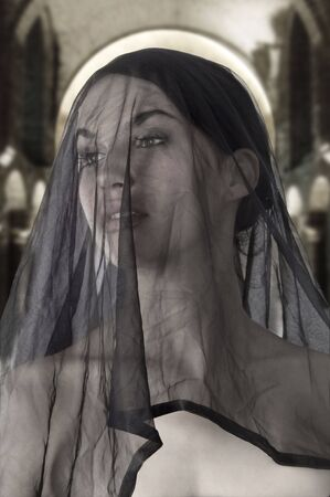 attractive widow with a black transparent veil on face photo