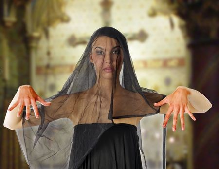 bloody widow with black veil on face inside a church photo