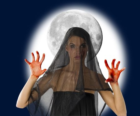 vestal: woman with black veil and bloody hand with a big moon in background Stock Photo
