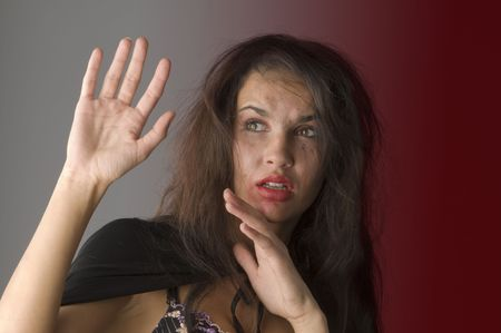 young woman in fear and keeping up hands as to defend from hit Stock Photo - 3689590