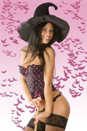 bruja sexy en ropa interior con sombrero negro y sonriente almacenamiento Foto de archivo - 3694001