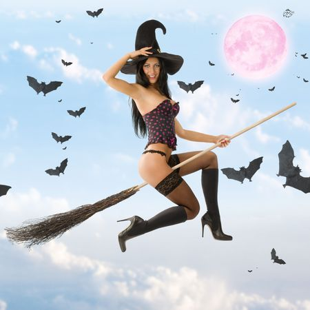 cute sexy witch in lingerie flying with her broom
