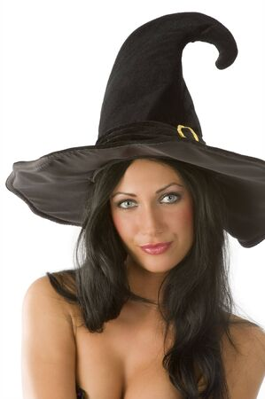 nice portrait of pretty and young brunette with blue eyes and witch hat photo