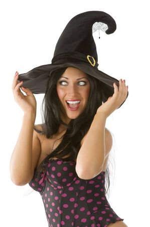 beautiful  brunette with blue eyes and witch hat on making face photo