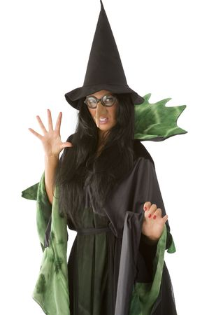 ugly girl: old and ugly witch in black and green dress with glasses Stock Photo