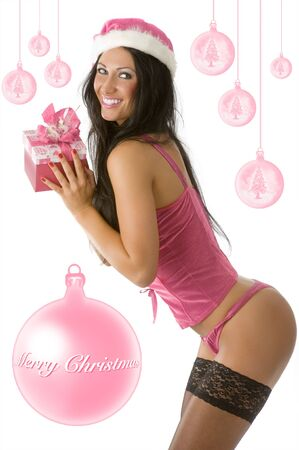 sexy girl in pink lingerie and stocking with gift box and christmas hat