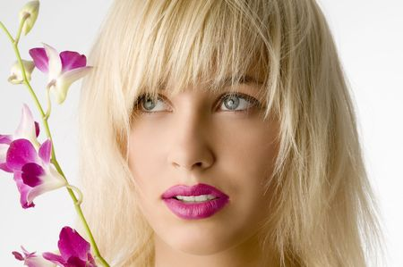 classic beauty style portrait of blond girl with flowers photo