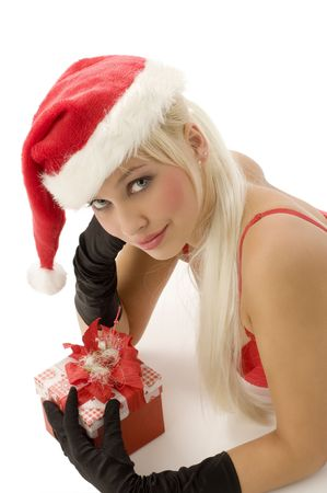close up of a young beautiful santa claus with gift box and gloves photo
