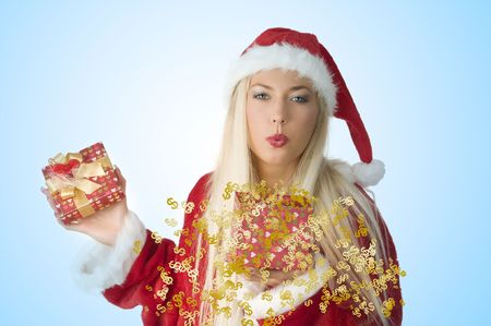 blond santa claus blowing on a red present box  photo