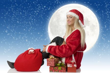 blond santa claus with gift and black boot sitting and smiling photo