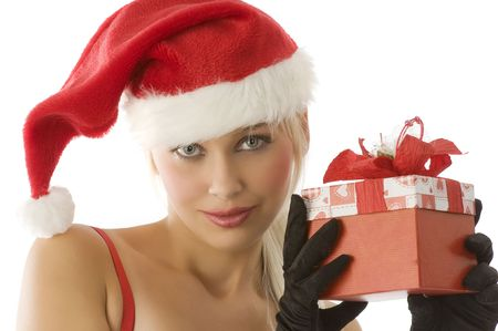 close up of young beautiful girl in santa claus with gift box photo