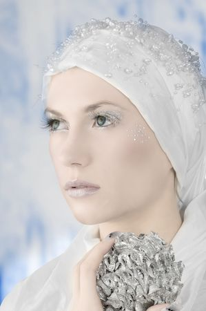 young woman in white with silver eyelashes and star on face Stock Photo - 3884751