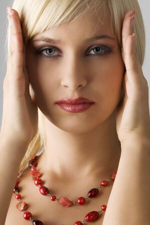 cute blond girl with glamor make up with red necklace Stock Photo - 4082231