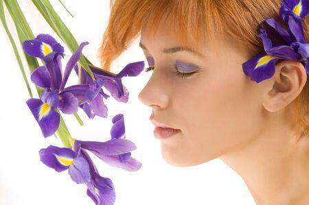 fresh portrait of cute redhead near purple flower with close eyes Stock Photo - 4104456