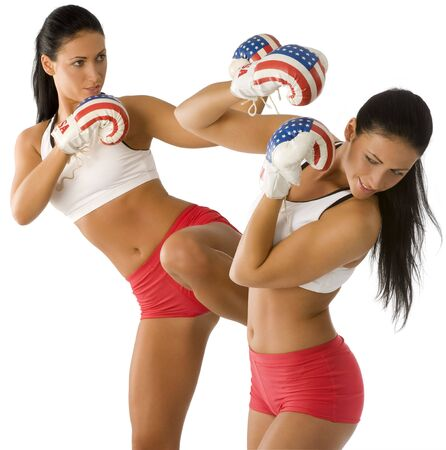 cute twins girls making boxe one defend herself from some coming punch and kick Stock Photo - 4118838