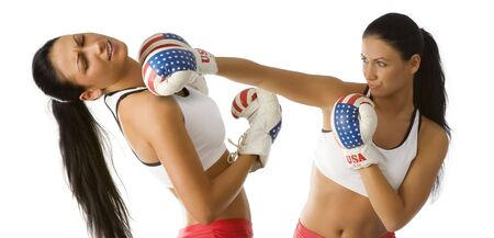 knock out: nice twins young women boxing fight one is knock out from a punch