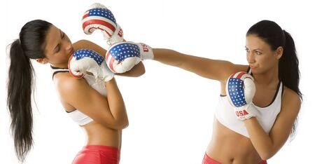twins nice young women in boxing dress in act to fight Stock Photo - 4118841