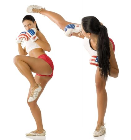 twins beautiful brunette with boxing gloves fighting and kicking Stock Photo - 4118836