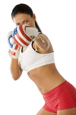 pretty girl giving a punch with boxing gloves with usa flag Stock Photo - 4122298