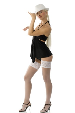 beautiful sexy blond girl in black dress with white hat and stockings photo
