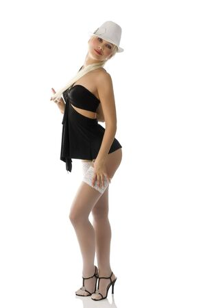 cute blond girl in black sexy dress with white hat and stockings photo