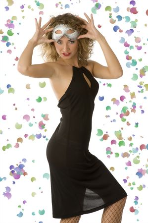 pretty young girl in elegant black dress taking off carnival mask Stock Photo - 4205623
