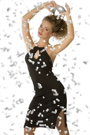 sensual young woman taking off a white carnival mask wearing black dress Stock Photo - 4205622
