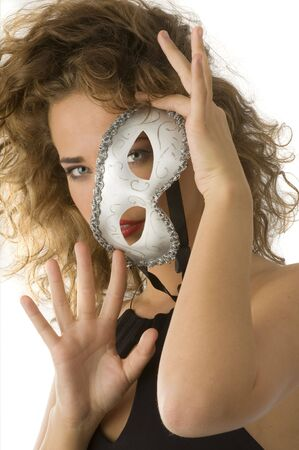 beautiful girl hiding her face behind a carnival mask Stock Photo - 4205626