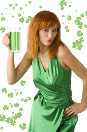 irish woman: cute red haired woman posing in green dress and drinking green beer