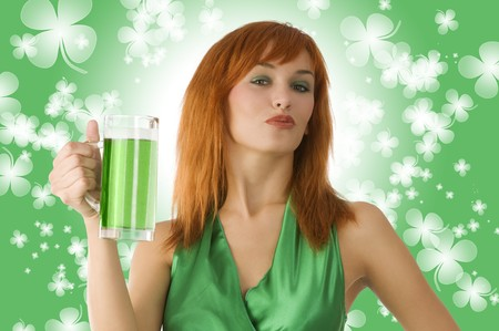 red haired Irish lass posing in green dress and drinking green beer photo