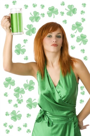 cute redhead girl posing in green dress with a glass of green beer Stock Photo - 4241487