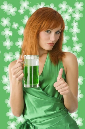 cute irish girl posing in green dress in positive expression with green beer Stock Photo - 4241520