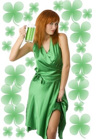 Sexy Irish Lass posing in green dress drinking green beer photo