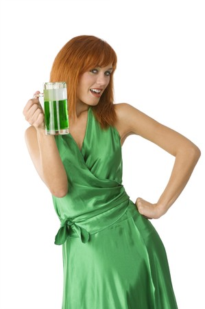 red head: red head girl in green dress and glass of green beer