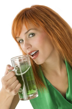 close up of young pretty woman with a glass of green beer photo