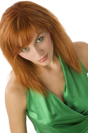cute portrait of a graceful young woman with red hair photo