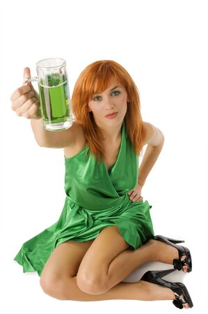 Sexy Irish Lass posing in green dress drinking green beer photo