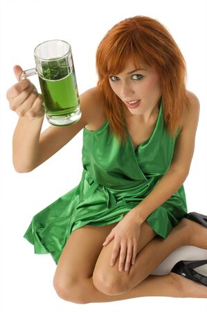 sexy red haired girl wearing a green dress drinking beer in saint patrick day photo