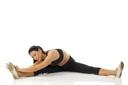 strecthing: pretty girl strecthing her body making gym