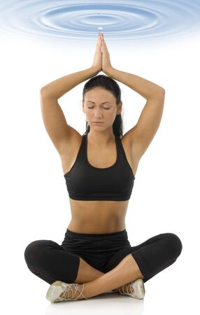 strecthing: cute brunette isolated on white in classic yoga meditation pose Stock Photo