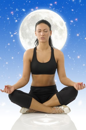cute brunette isolated on white in classic yoga meditation pose photo