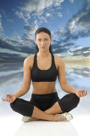 strecthing: cute young woman isolated on white in classic yoga meditation pose