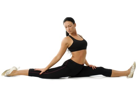 strecthing: pretty girl strecthing her legs ina a gymnastic pose  Stock Photo