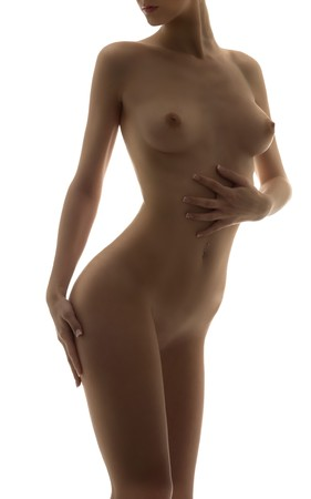beauty portrait of a young naked woman with great body in backlight