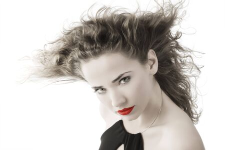 cute portrait of young charming woman with stunning eyes and windly hair photo