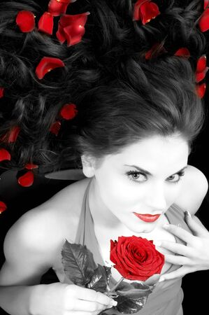 wide angle portrait of pretty woman with red dress rose and petals Stock Photo - 4367266