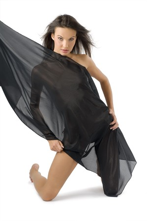 nice young woman covering her body with black fabric and wind in hair photo