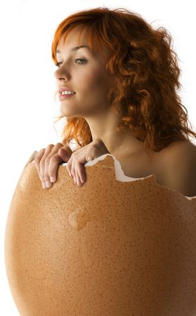 girl coming up from a broken egg like a chick looking cuus Stock Photo - 4413808