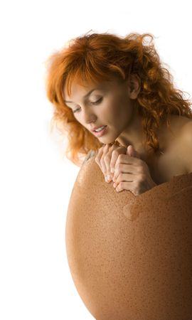 girl coming up from a broken egg like a chick Stock Photo - 4413806